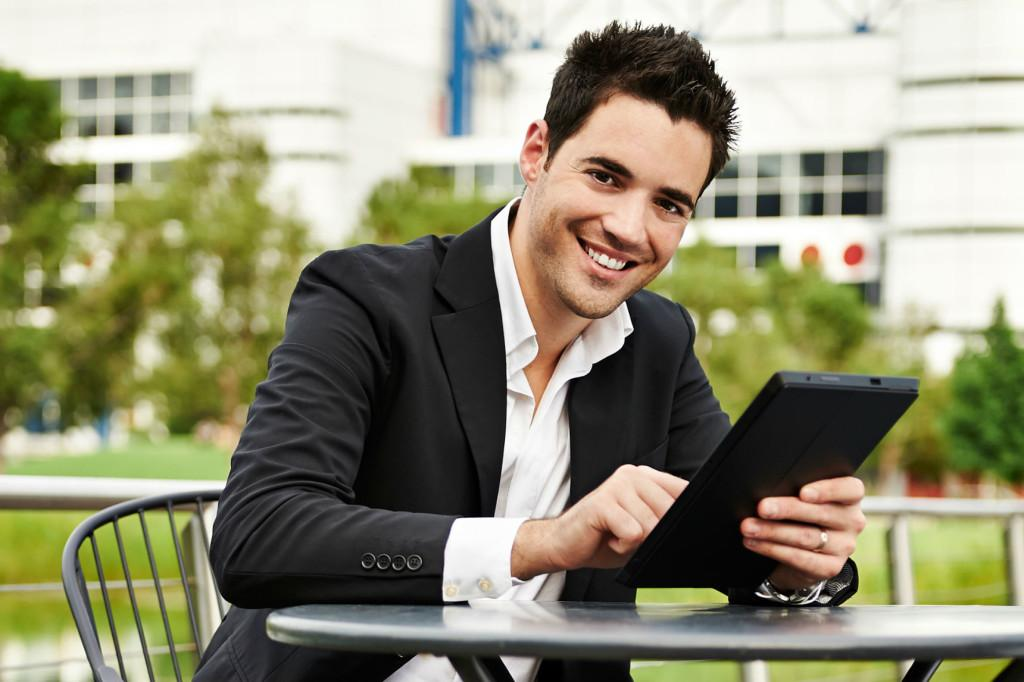 shutterstock_148850267-Young-successful-businessman-with-tablet-outdoors-luxe-beat-magazine-feature