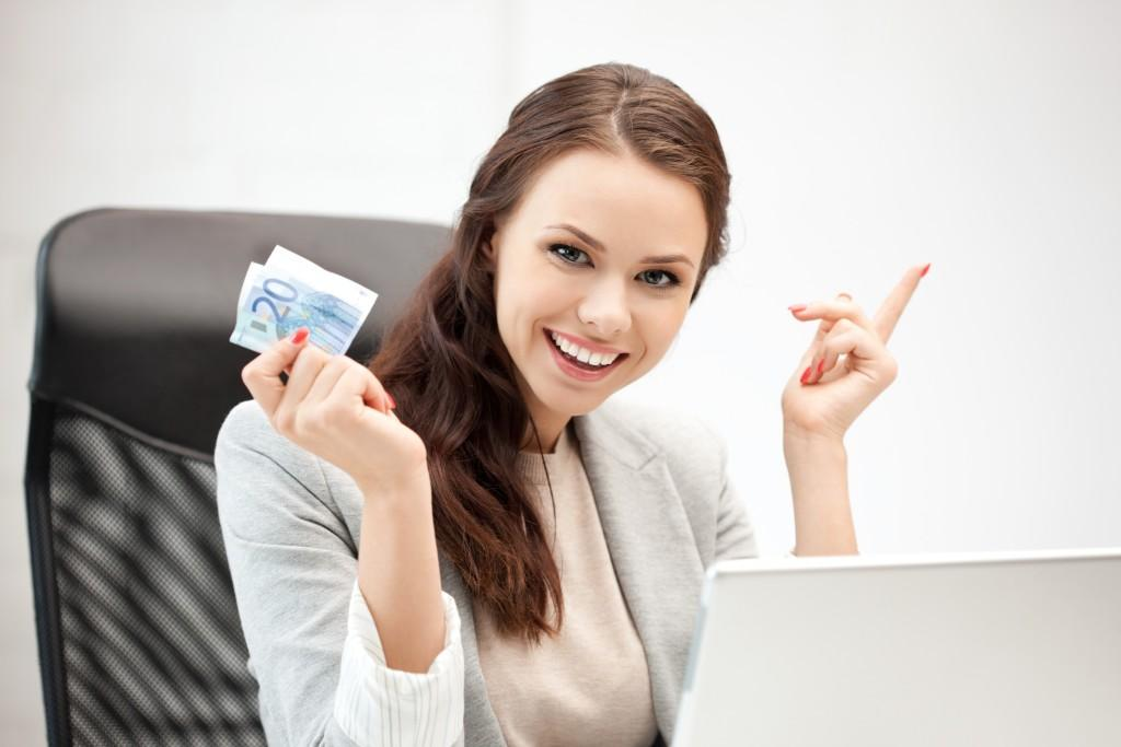 woman with laptop computer and euro cash money